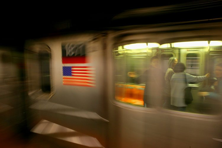 Riders and Flag : Passing Subway Car : C train 23rd St NYC
