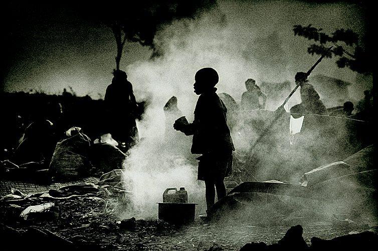 Boy in Smoke at time of Rwandan Genocide : Goma Rwandan Border : Rwanda