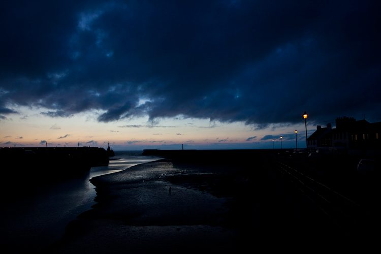 Harbour Entrance In The Last Slither of Light : Maryport : Cumbria UK