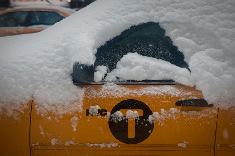 Taxi Under Snow : 8th Av and 50th : New York City